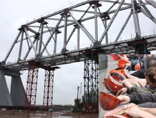 Рабочим-строителям Нижнеленинского железнодорожного моста не выплачивают заработную плату